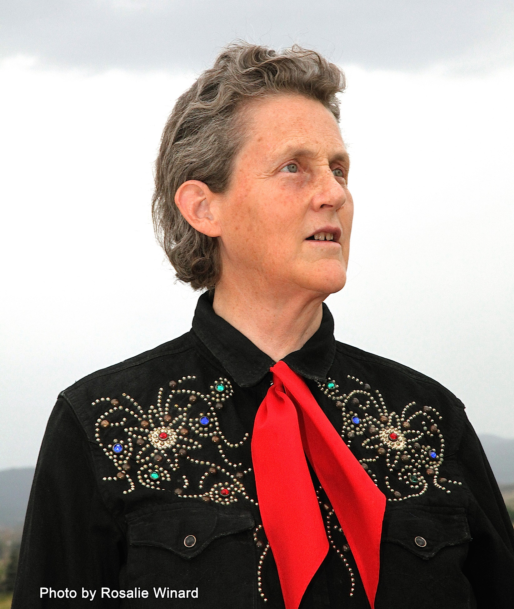 Image of Temple Grandin wearing a black shirt and red tie